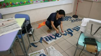 Ate Rochie busy preparing for the letterings and decorations